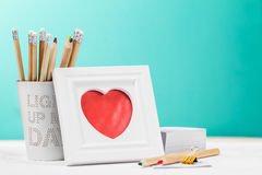 Love concept with photo frame, pencils and red heart. Horizontal Stock Photos