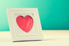 Love concept with photo frame and red heart. Horizontal with cop Royalty Free Stock Images