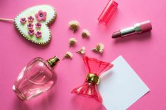 Free Love Concept - Pink Adorable Perfume, Gingerbread Heart, Lipstick, Flowers On Pink Background. Copy Space For Text. Woman Make Up Royalty Free Stock Image - 140115576