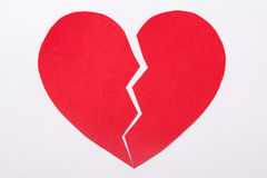 Love concept - red paper broken heart over white Royalty Free Stock Images