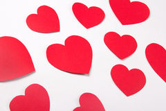 Love concept - red paper hearts over white Stock Photo