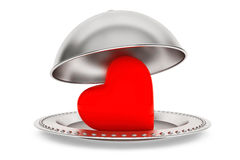 Love concept. Silver Restaurant cloche with heart Stock Images