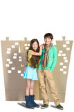 Love concept. Stylish boy and girl hugging each other on background of cardboard city Stock Photography