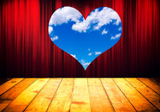 Love concept. Theater stage with red curtain and heart shape window Stock Images