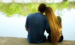 Love concept - two lovers hugging near park lake Stock Images