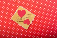 Love concept for valentine's day. Love icon and Valentine's day wording on torn paper Royalty Free Stock Photo