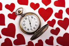 Concept for valentine's day on  retro watch. Love concept for valentine's day on  retro watch Stock Photos