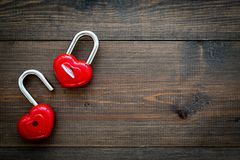 Love concept. Valentine`s day symbol. Locks in shape of heart o dark wooden background top view copy space. Love concept. Valentine`s day symbol. Locks in shape stock image