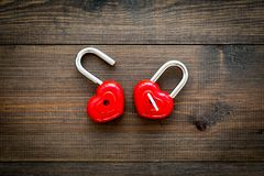 Love concept. Valentine`s day symbol. Locks in shape of heart o dark wooden background top view copy space. Love concept. Valentine`s day symbol. Locks in shape royalty free stock images