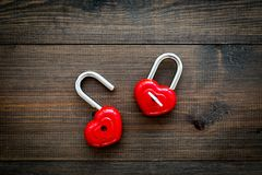 Love concept. Valentine`s day symbol. Locks in shape of heart o dark wooden background top view copy space. Love concept. Valentine`s day symbol. Locks in shape royalty free stock photos