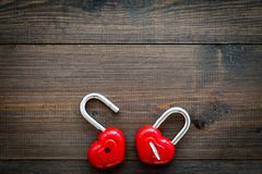Love concept. Valentine`s day symbol. Locks in shape of heart o dark wooden background top view copy space. Love concept. Valentine`s day symbol. Locks in shape royalty free stock image