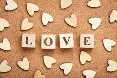 Love concept wooden cubes and hearts Stock Photos