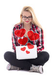 Love concept - young blondie woman sitting with laptop isolated Stock Photo