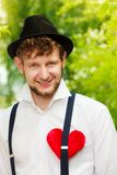 Young man retro style with red heart on chest Royalty Free Stock Image