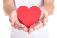 Love concept - young man holding red paper heart Stock Images