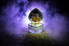 Love concepts of wedding teddy bear in silver heart gift box on table for valentines day and wedding. Dark smoky toned background. Selective focus Royalty Free Stock Photos
