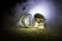 Love concepts of wedding teddy bear in silver heart gift box on table for valentines day and wedding. Dark smoky toned background. Selective focus Royalty Free Stock Image