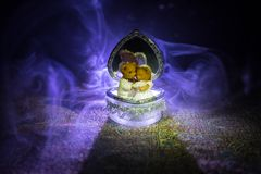 Love concepts of wedding teddy bear in silver heart gift box on table for valentines day and wedding. Dark smoky toned background. Selective focus Stock Photography