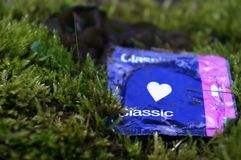 Love condom in the grass Stock Images