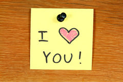 Love confession. Sticky note with love confession - I Love You. Bulletin board Royalty Free Stock Photography