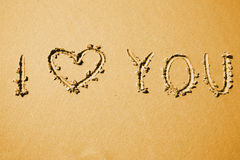 Love confession. I love you written on a beach sand. Background texture Stock Photo