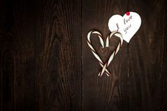 Love Confession. And the heart of sweets on the dark wooden background Stock Photos
