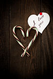 Love Confession. And the heart of sweets on the dark wooden background Royalty Free Stock Photo