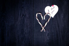 Love Confession. And the heart of sweets on the dark wooden background Stock Images