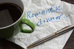 Love confession on napkin. Romantic message written on napkin and cup of coffee on wooden table Stock Photography