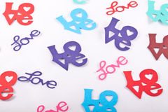 Love Confetti. Confetti shaped into the word Love in various fonts and colours Royalty Free Stock Photos