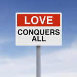Love Conquers All. A conceptual sign on Love Royalty Free Stock Photo