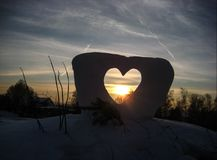 Love construction. Winter sunset in Ukraine stock images