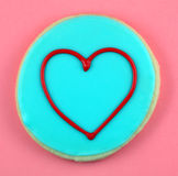 Love Cookie. Heart cookie on a red background royalty free stock photo