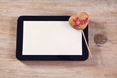 Love Cookie And Digital Tablet Stock Photos