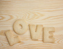 Love cookies. Word love spelled with home made cookies on a wooden table. Valentine's Day baking concept royalty free stock images