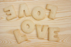 Love cookies. Word love spelled with home made cookies on a wooden table. Valentine's Day baking concept stock images