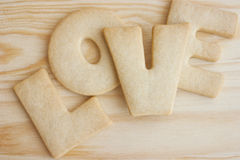 Love cookies. Word love spelled with home made cookies on a wooden table. Valentine's Day baking concept stock photos