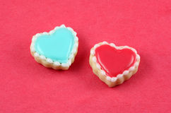 Love Cookies. Heart cookies on a red background Royalty Free Stock Image