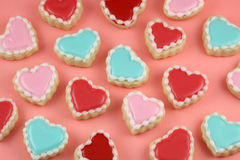 Love Cookies. Heart cookies on a teal background royalty free stock image