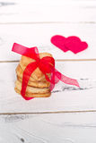 Love cookies. Some cookies hearts tied with red ribbon and textile hearts around Royalty Free Stock Image