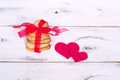 Love cookies. Some cookies hearts tied with red ribbon and textile hearts around Royalty Free Stock Photo