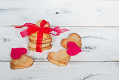 Love cookies. Some cookies hearts tied with red ribbon and textile hearts around Stock Image