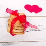 Love cookies. Some cookies hearts tied with red ribbon and textile hearts around Royalty Free Stock Images