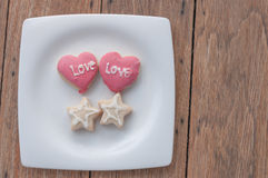 Love cookies in white dish Royalty Free Stock Images