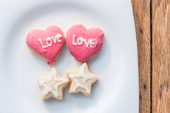 Love cookies in white dish Stock Photos