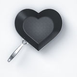 Love cooking. Heart shape pan on white background Stock Photos
