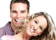 Love coulple. Young love couple smiling. Over white background Stock Photos