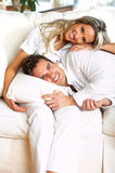 Love couple. Young love couple smiling in the comfortable apartment stock photos
