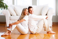 Love couple. Young love couple smiling in the comfortable apartment stock photography