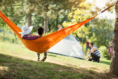 Love couple from back in hammock Royalty Free Stock Photo